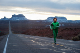 Creative commercial image of runner in Monument Valley mimicking the scene in Forrest Gump