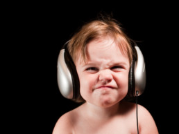 Studio Portrait of child with headphones - commercial portrait