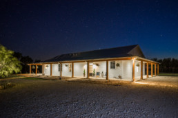 Night time image of ranch house in Graham, TX
