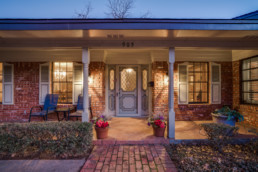 A twilight exterior real estate image of a home in Burkburnett, Texas