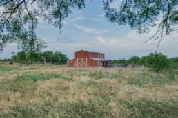 A farm & ranch real estate image of a barn at a ranch listing on the outskirts of Wichita Falls, Texas