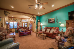 A real estate photograph of an interior of a home, a living room, in Wichita Falls, TX