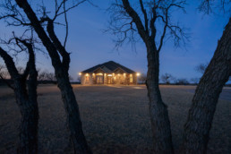 A twilight exterior real estate photograph of a listing near Wichita Falls, TX