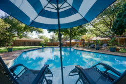 Real estate photograph of two chairs poolside at a real estate listing in Wichita Falls, TX