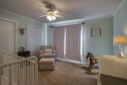 Real estate photograph of a nursery room in Wichita Falls, TX