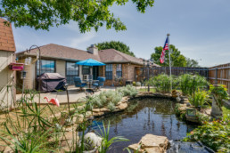 A real estate photo of a koi pond at a home in Wichita Falls, TX
