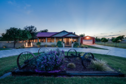 A twilight exterior image of a ranch listing in Wichita Falls, TX